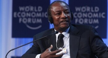 Guinea's President Conde attends a session at the World Economic Forum (WEF) in Davos